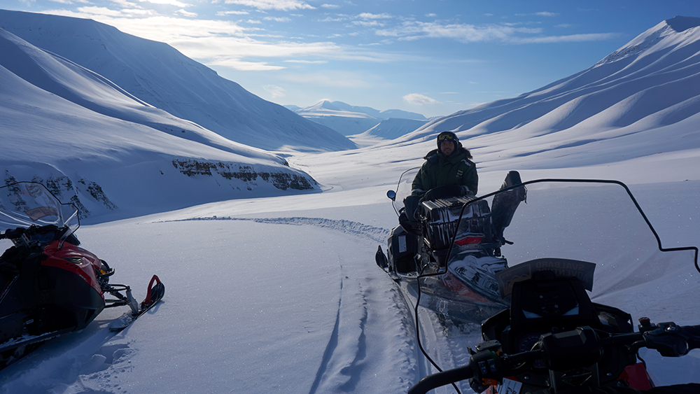 Snowscooter driving in Svalbard